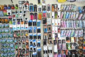 Photo of inside shop of accessories hanging on a peg board display.