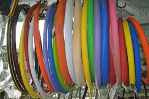 Photo of misc. tires hanging from a rack